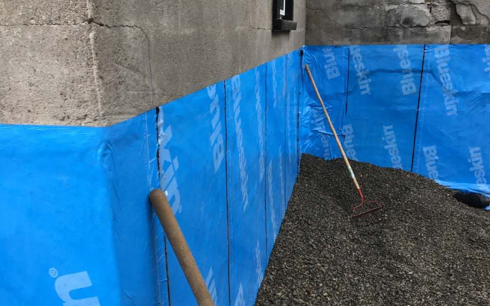 blue plastic protective covering installed on a wall